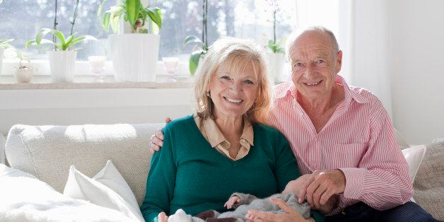 proud grandparents holding newborn grandson
