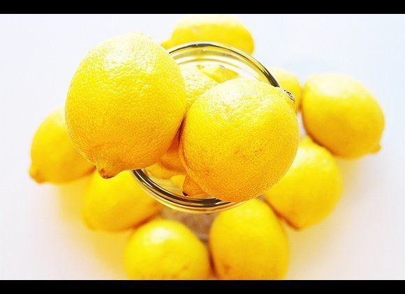 Nothing ruins a trip like getting sick, which is why you'll want to get in the habit of asking for water with lemon. Because