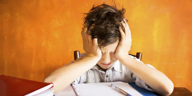 young boy stressed on homework