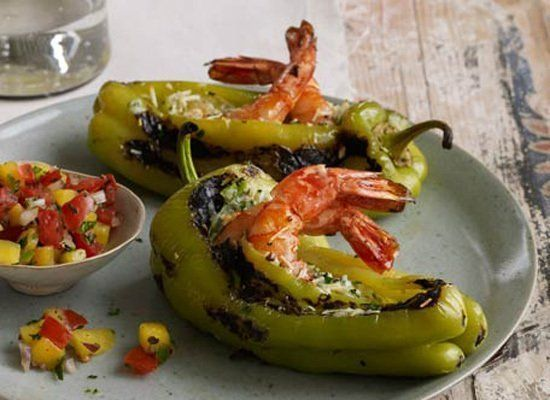 These peppers are stuffed with a combination of shredded cheeses and shrimp, then served with mango salsa. Use guero, Hungari