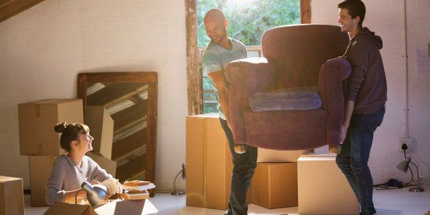Friends Moving Furniture In New Home
