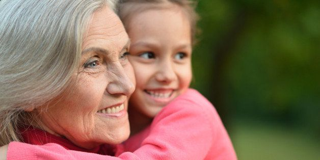 Little cute girl with her grandmother in summer park
