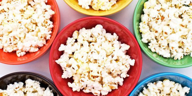 Popcorn in rainbow bowls arranged to fill the frame.