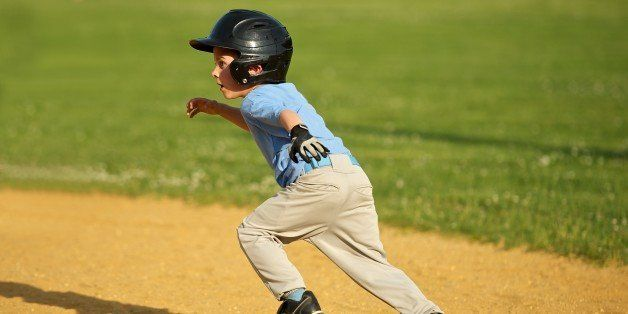 Small little league baseball player running toward Second Baseball during a Baseball Game.