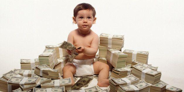 Toddler sitting on stacks of money