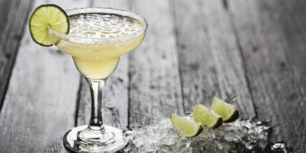 Margarita on wood table, with ice and lime decoration