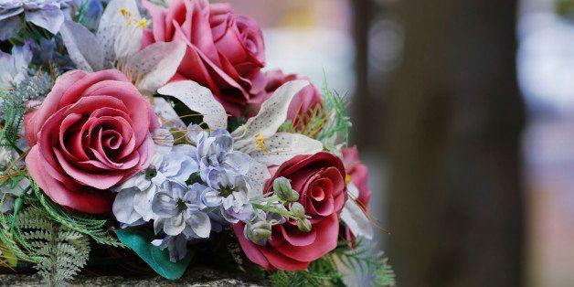Silk flowers on a gravestone
