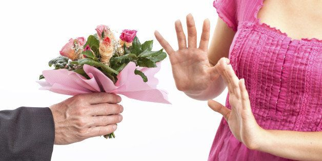 Angry wife refusing a flowers for apology