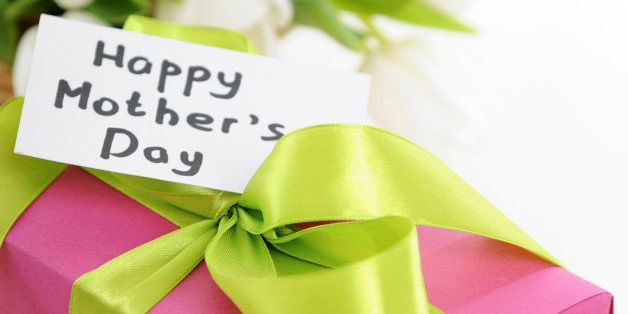 gift and bouquet of white tulips with a card, 'Happy Mother's Day'