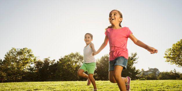 USA, California, Ladera Ranch, Sisters (6-7, 8-9) playing in park