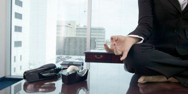 Woman meditating on desk
