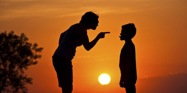 A silhouette of a mother scolding a disrespectful child. Relationship and parenting concept. Discipline. Poor behavior.