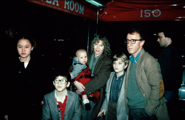 Soon Yi Previn, seen far left. Actress Mia Farrow is holding her daughter, Dylan Farrow.