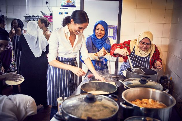 The Duchess of Sussex cooking with women in the Hubb Community Kitchen at the Al Manaar Muslim Cultural...