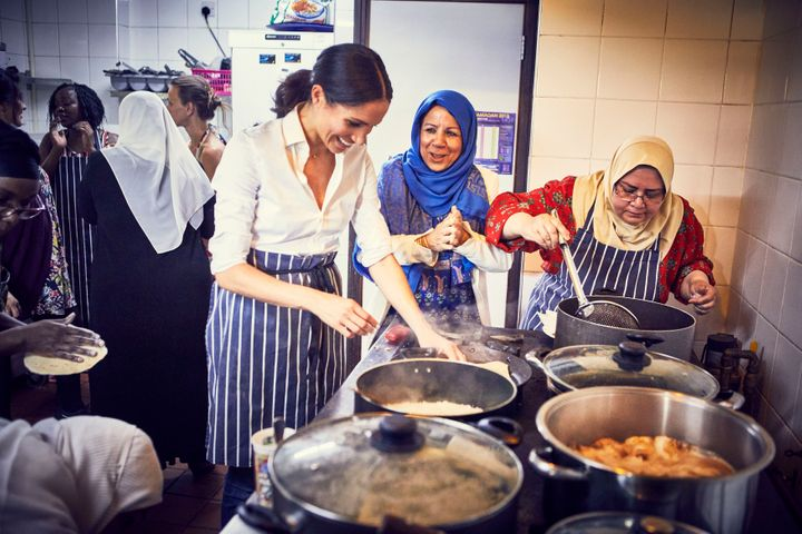 The Duchess of Sussex cooking with women in the Hubb Community Kitchen at the Al Manaar Muslim Cultural Heritage Centre in West London, in the aftermath of the Grenfell Tower fire.