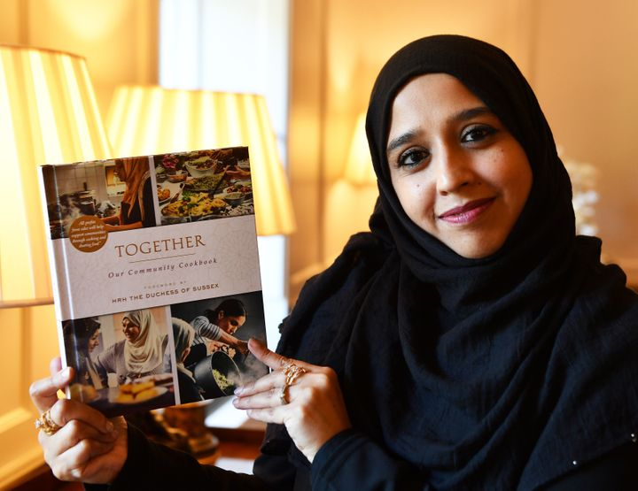 Zahira Ghaswala at Kensington Palace holding a copy of Together, a book that tells how women came together after the Grenfell Tower tragedy to cook for the local community, which has a foreword by the Duchess of Sussex.<i></i><i></i>