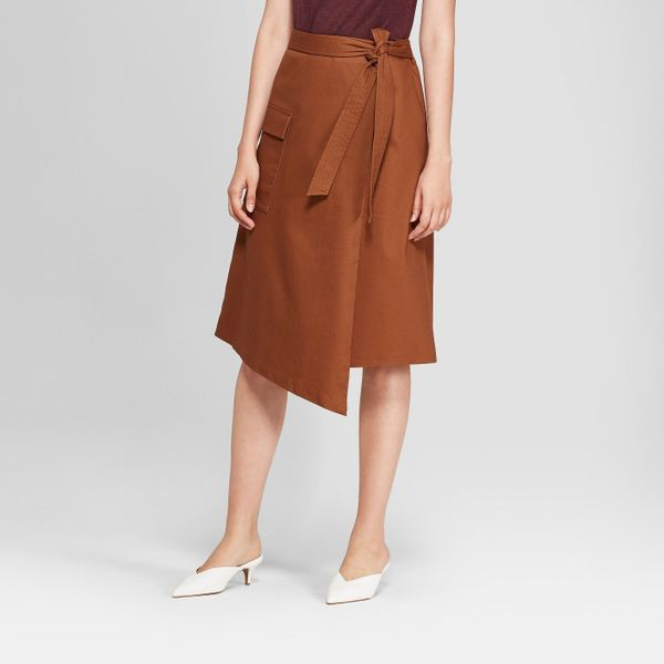 "<strong>Sizes</strong>: 2 to 18<br>Get it at <a href=""https://www.target.com/p/women-s-asymmetrical-wrap-skirt-prologue-153-b"