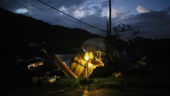 MOROVIS, PUERTO RICO - DECEMBER 25:  A donated solar lamp in a driveway illuminates storm debris still waiting to be collected on Christmas day on December 25, 2017 in Morovis, Puerto Rico. Thirty percent of the devastated island is still without electricity. While the official death toll from the massive storm remains at 64, The New York Times recently reported the actual toll for the storm and its aftermath likely stands at more than 1,000. A recount was ordered by the governor as the holiday season approached.  (Photo by Mario Tama/Getty Images)