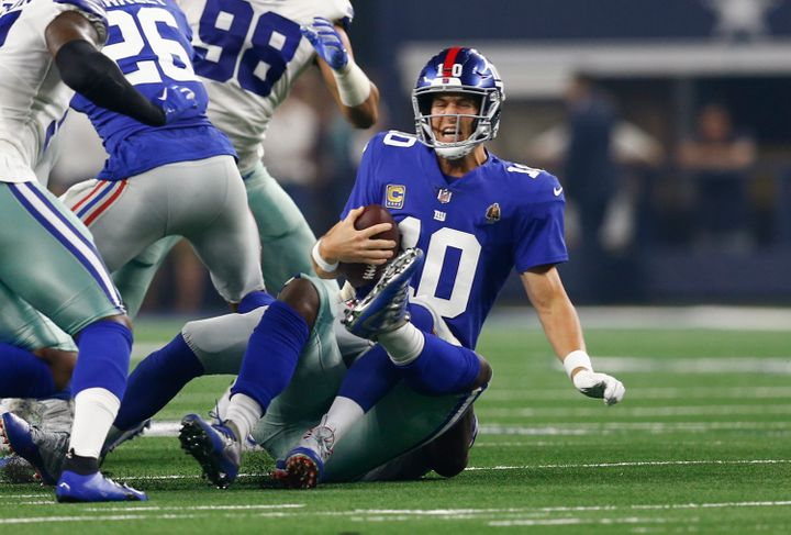 Eli Manning gets sacked by the Cowboys' Demarcus Lawrence.