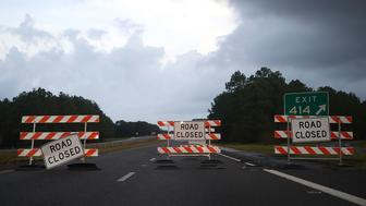 WILMINGTON, NC - SEPTEMBER 17: Road closed signs sit on Rt40 due to flooding, on September 17, 2018 in Wilmington, North Carolina. Hurricane Florence hit Wilmington as a category 1 storm causing widespread power outages and flooding across North Carolina.  (Photo by Mark Wilson/Getty Images)