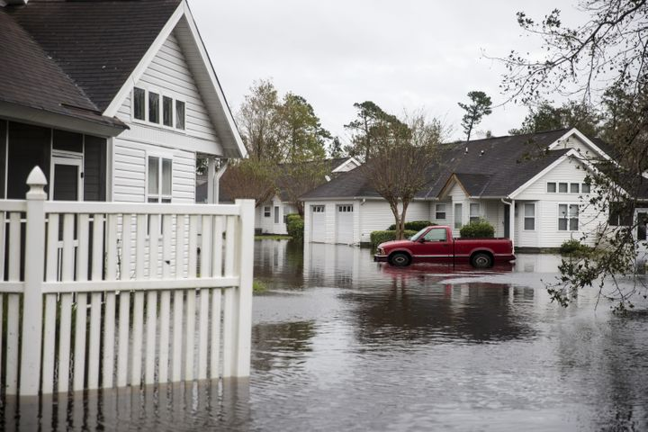 A truck sits partially submerged in a flooded neighborhood after Hurricane Florence hit in Wilmington, North Carolina, U.S.,