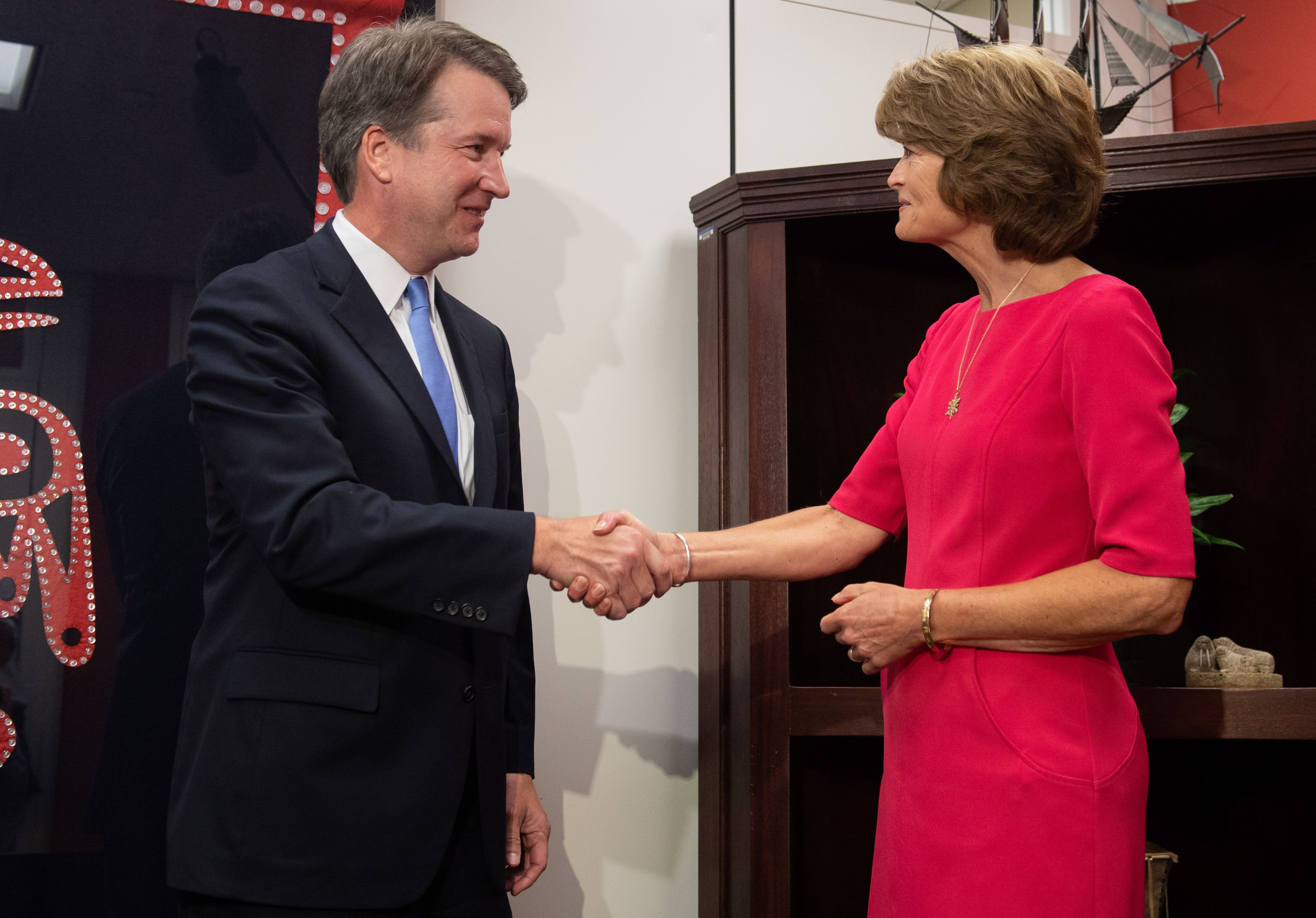 US Senator Lisa Murkowski, Republican of Alaska, shakes hands with US Supreme Court associate justice nominee Brett Kavanaugh prior to a meeting on Capitol Hill in Washington, DC, August 23, 2018. (Photo by SAUL LOEB / AFP)        (Photo credit should read SAUL LOEB/AFP/Getty Images)