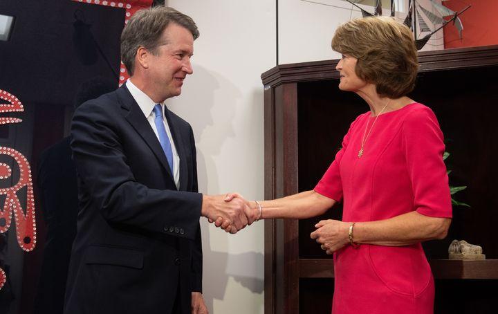 Supreme Court nominee Brett Kavanaugh and Sen. Lisa Murkowski (R-Alaska) meet on Aug. 23 on Capitol Hill.