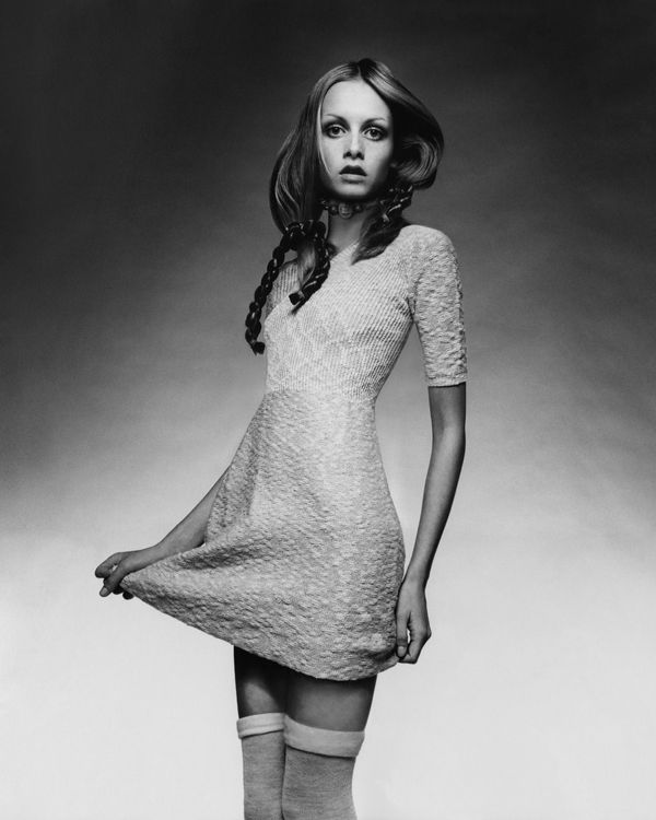 Twiggy wears a knit baby-doll dress with a ribbed bodice by Juliano Knits with thigh-high socks, a choker by Mary Smith and b