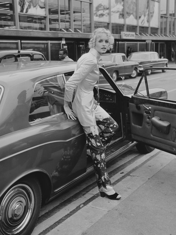 The model arrives at Heathrow Airport.