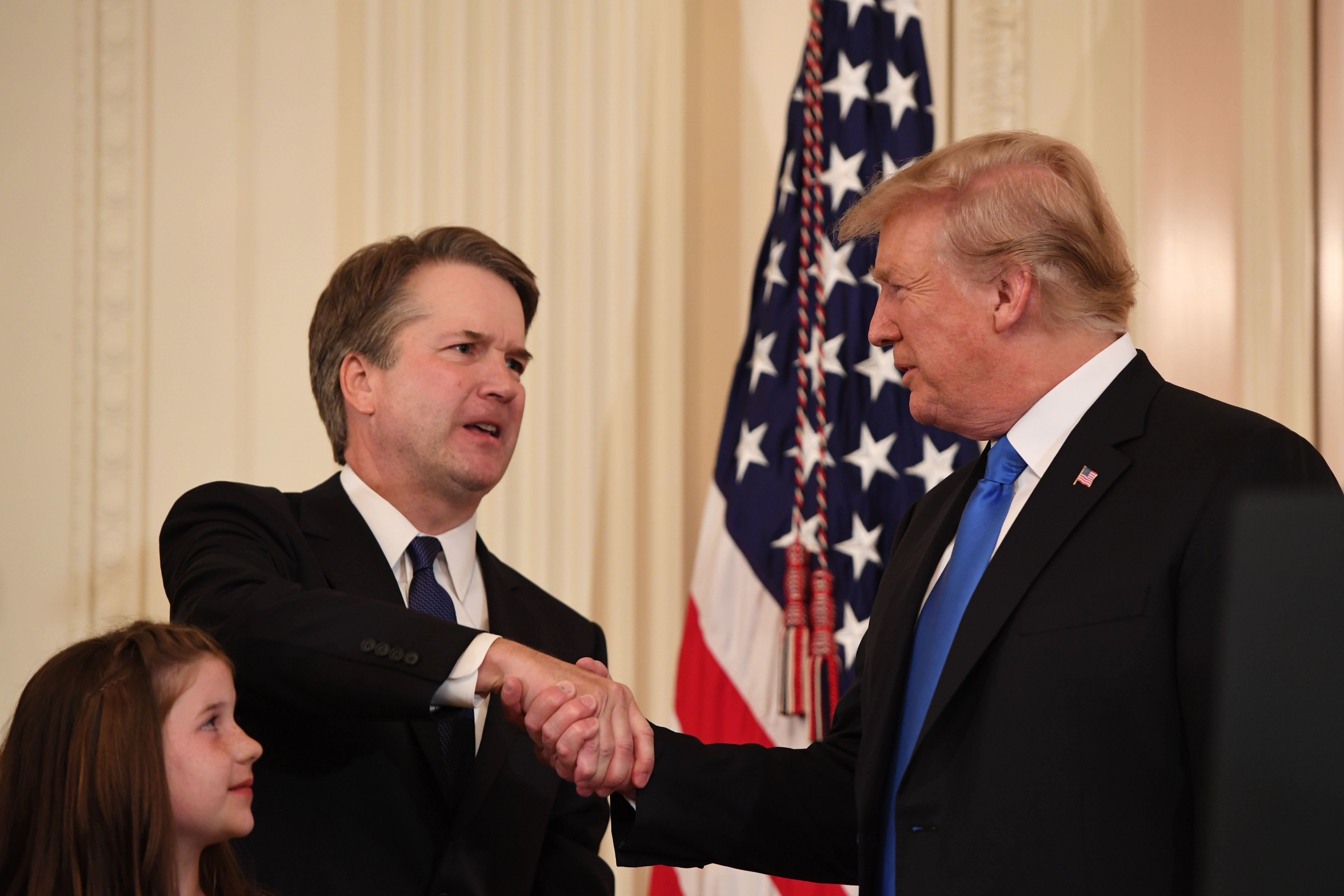 US Judge Brett Kavanaugh (L) shakes hands with US President Donald Trump after being nominated to the Supreme Court in the East Room of the White House on July 9, 2018 in Washington, DC. (Photo by SAUL LOEB / AFP)        (Photo credit should read SAUL LOEB/AFP/Getty Images)