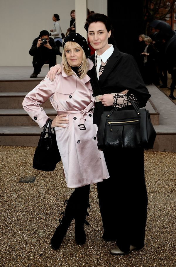 Models Twiggy and Erin O'Connor attend the Burberry Prorsum fall/winter 2010 womenswear show at the Parade Ground at Chelsea