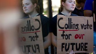 PORTLAND, ME - SEPTEMBER 14: Laura Friel, class of 2022, joins fellow Bowdoin students at Congress Square in Portland before marching to Sen. Susan Collins' office on Friday, September 14, 2018, to urge her to vote against the confirmation of Supreme Court nominee Brett Kavanaugh. (Staff photo by Derek Davis/Portland Press Herald via Getty Images)