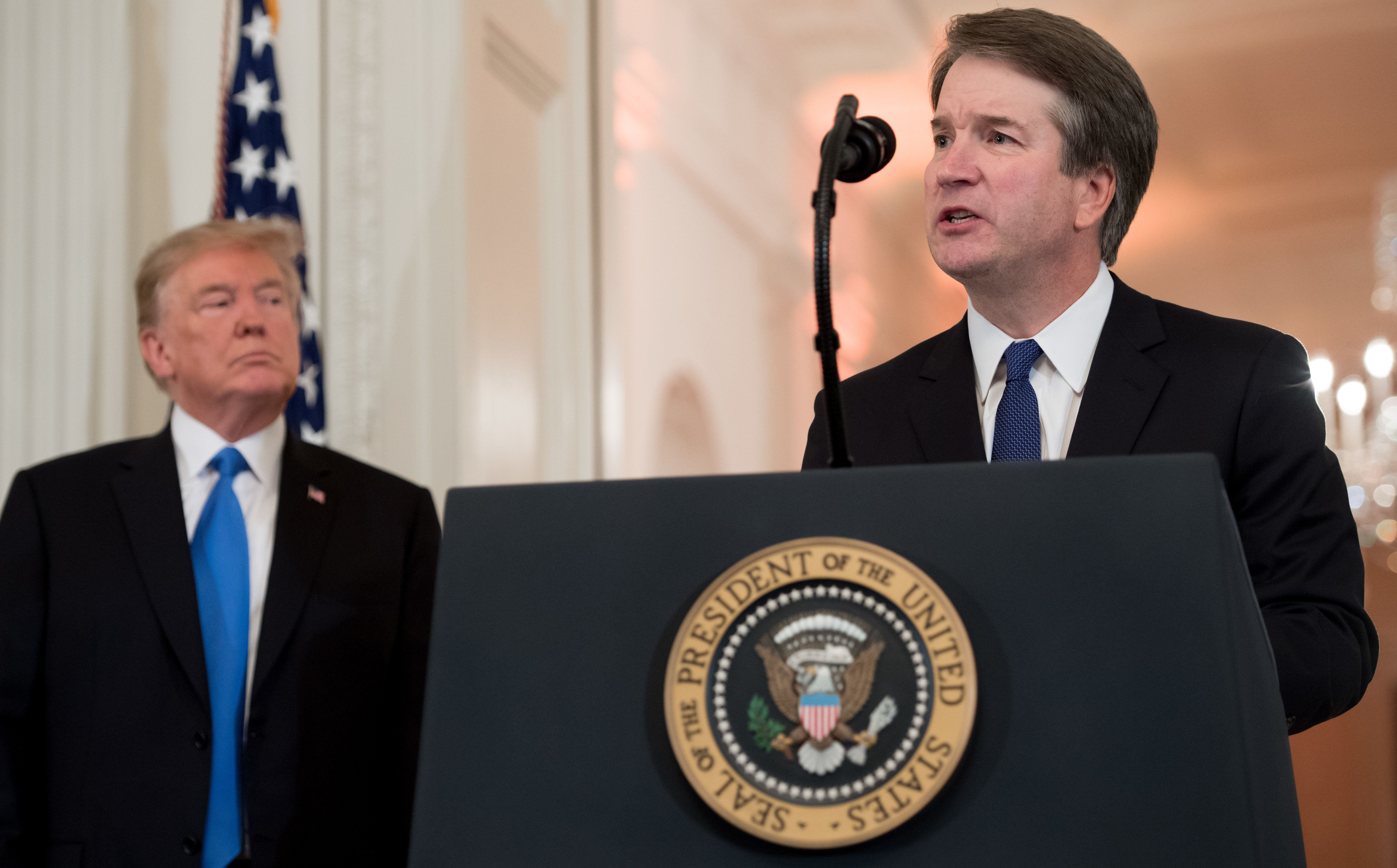 US Judge Brett Kavanaugh speaks after being nominated by US President Donald Trump (L) to the Supreme Court in the East Room of the White House on July 9, 2018 in Washington, DC. (Photo by SAUL LOEB / AFP)        (Photo credit should read SAUL LOEB/AFP/Getty Images)