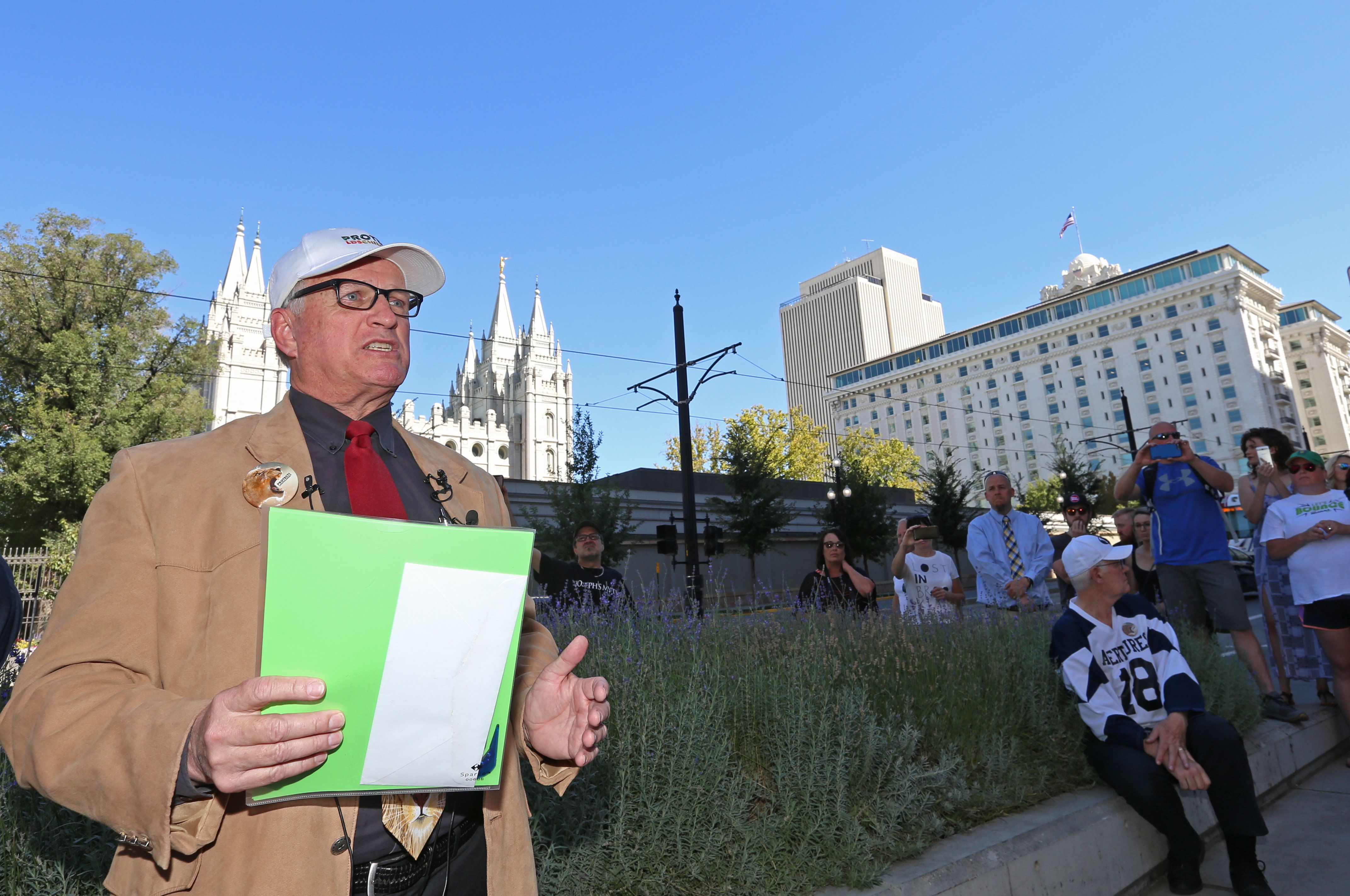 SALT LAKE CITY, UT - SEPTEMBER 16: Sam Young, former Mormon bishop and founder of Protect the Children, talks to supporters before he opens a letter to find out if he has been excommunicated from the Church of Jesus Christ of Latter-Day Saints, across the street from the world headquarters of the Mormon church, on September 16, 2018 in Salt Lake City, Utah. Young was excommunicated from the Mormon church after he started to protest and demanded sexual explicit interviews with children by Mormon Church Leaders to stop.   (Photo by George Frey/Getty Images)