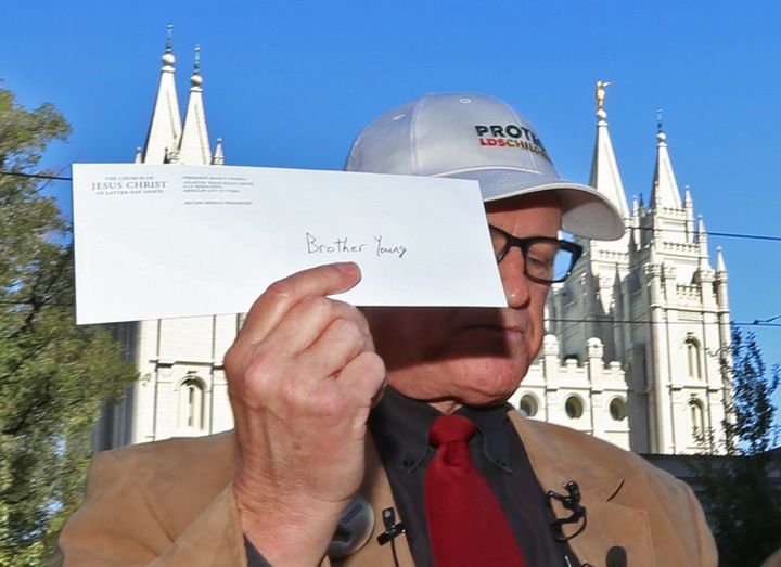 Sam Young holds up a letter that informs him that he has been excommunicated from the Church of Jesus Christ of Latter-Day Sa