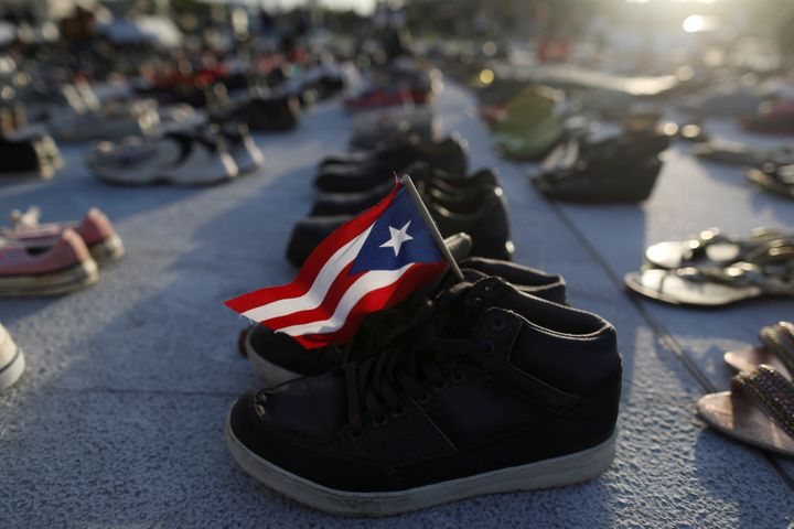 A Puerto Rican flag is seen on one of the hundreds of pairs of shoes displayed at the Capitol to pay tribute to Hurricane Mar