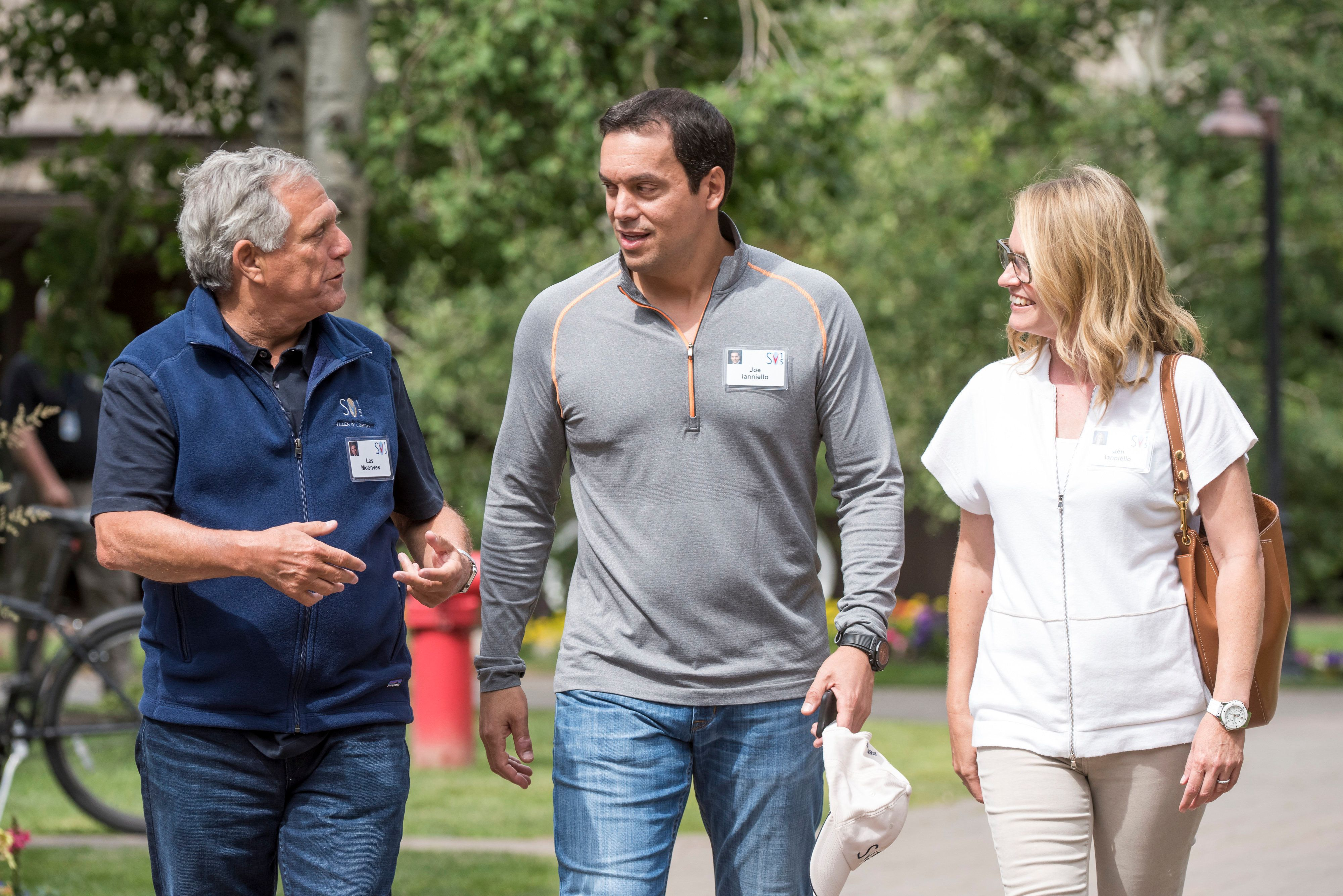 Leslie Moonves, president and chief executive officer of CBS Corp., left, talks with Joe Ianniello, chief operating officer of CBS Corp., center, and Jen Ianniello as they walk the grounds after a morning session during the Allen & Co. Media and Technology Conference in Sun Valley, Idaho, U.S., on Wednesday, July 8, 2015. Billionaires, chief executive officers, and leaders from the technology, media, and finance industries gather this week at the Idaho mountain resort conference hosted by investment banking firm Allen & Co. Photographer: David Paul Morris/Bloomberg via Getty Images