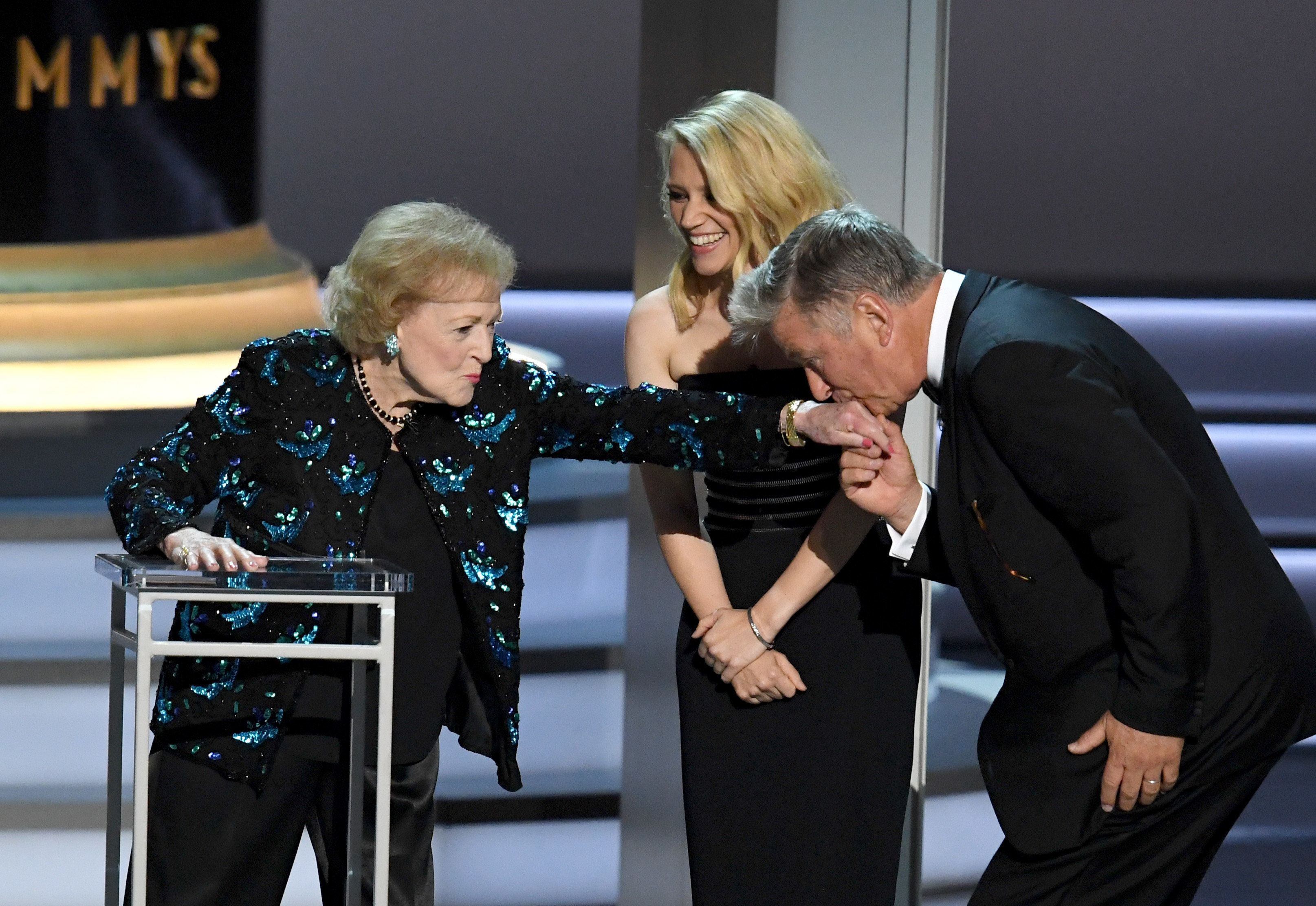 Betty White, fifth-wheel Kate McKinnon and Alec Baldwin onstage at the 70th Emmy