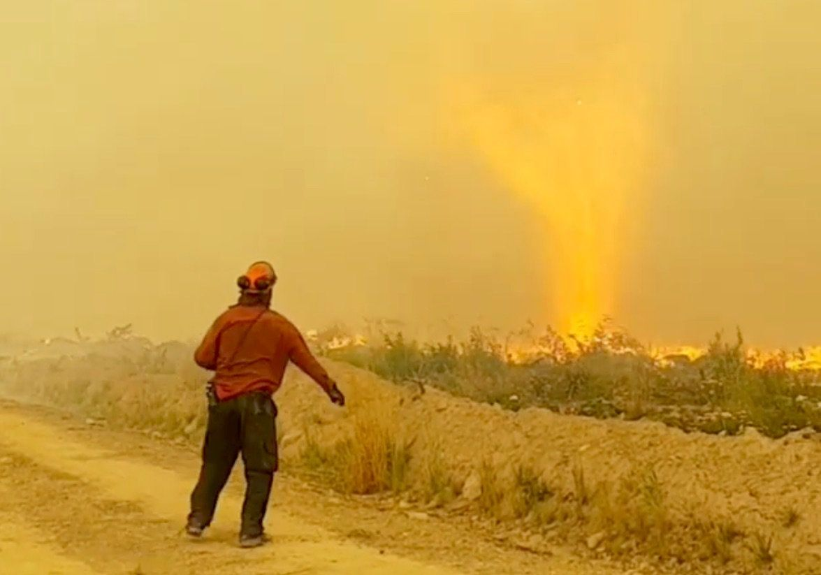 BC firefighter captures video of firenado sucking up hose