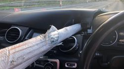 Shocking Pictures Reveal Driver's Miraculous Escape After Metal Pole Impales Car On