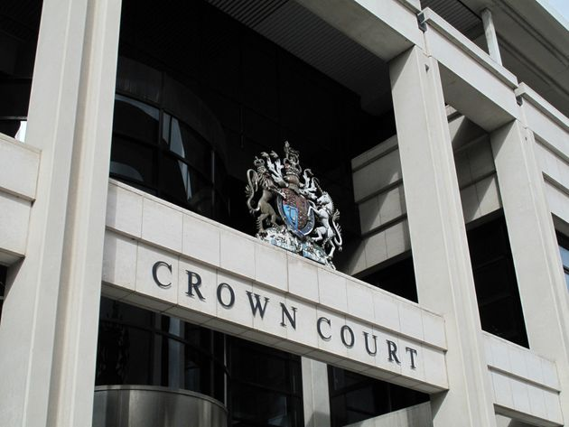 Exterior of Kingston Crown Court where the parents of an 18-year-old stand accused of controlling...