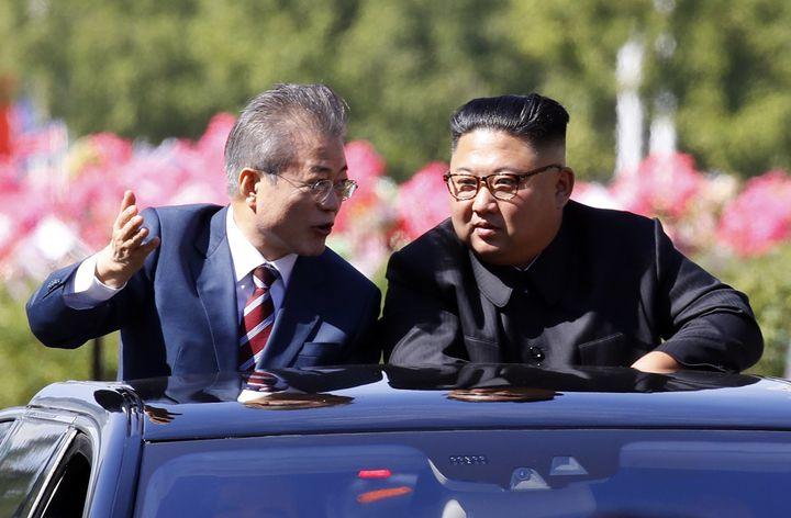 South Korean President Moon Jae-in (L) and North Korean leader Kim Jong Un ride in a car parade on Sept. 18, 2018, in Pyongya