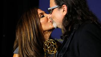 """70th Primetime Emmy Awards - Photo Room - Los Angeles, California, U.S., 17/09/2018 - Glenn Weiss poses backstage with his Outstanding Directing for a Variety Special award for """"The Oscars"""" and with Jan Svendsen, after he proposed marriage to her on stage during the show. REUTERS/Mike Blake"""