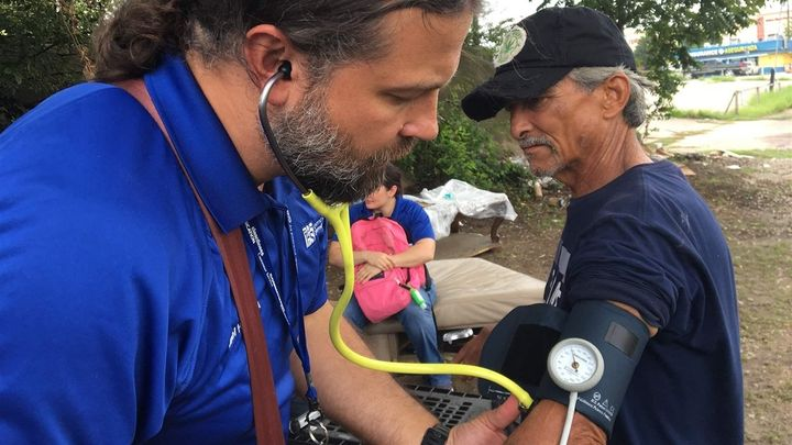 Physician assistant Joel Hunt treats Raul Reyes, 59, at a homeless encampment outside of downtown Fort Worth, Texas.