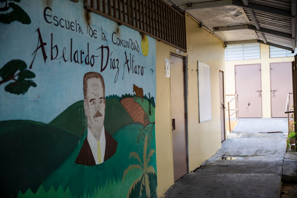 A mural at Abelardo Díaz Alfaro elementary school, with locked classroom doors in the background.