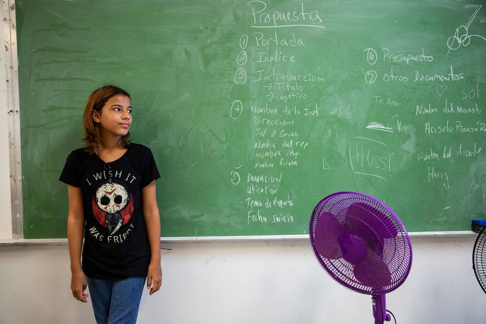 Even before Hurricane Maria hit, Lizxayra Meléndez Trinidad, 12, had been getting help from Román Barranco and