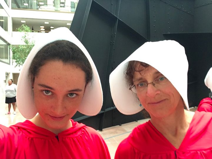 Margot Block (left) and Nadine Bloch (right), dressed as Handmaids.