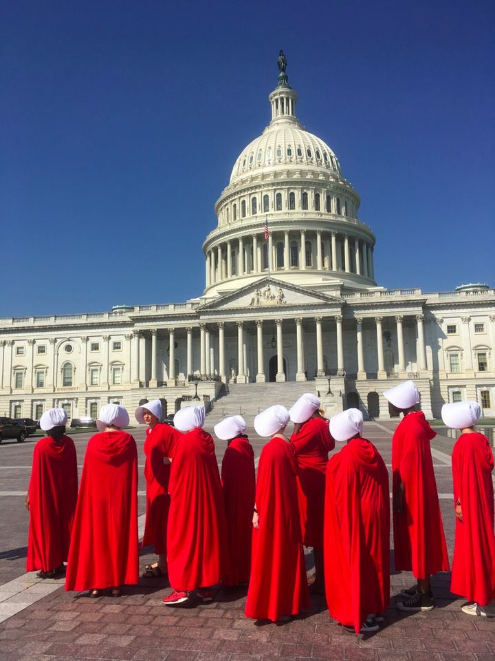 Nadine and Margot Bloch and other women dressed as Handmaids on Capitol Hill on Sept. 4, 2018.