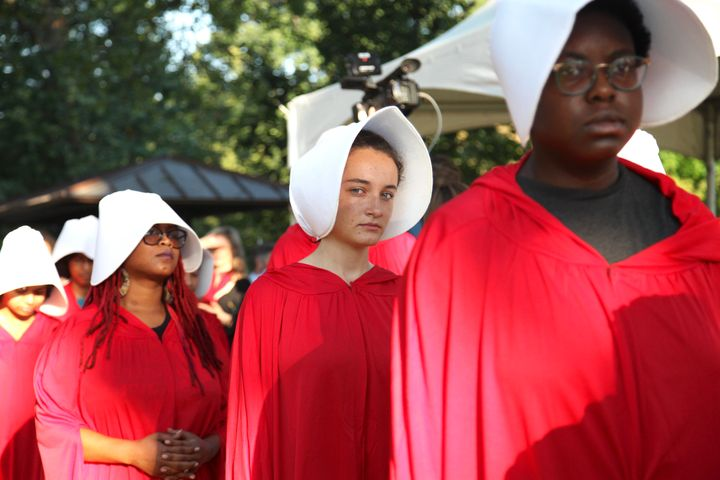 Margot Bloch (center) dressed as a Handmaid on Sept. 4, 2018