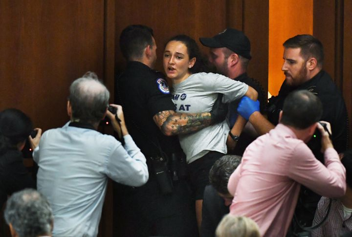 Margot Bloch being detained by police after she disrupted Brett Kavanaugh's Supreme Court confirmation hearing on Sept. 4, 20